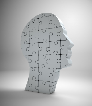 A male head build out of puzzle pieces Stock Photo