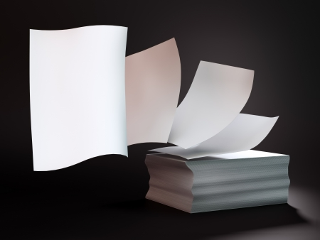 stacked up: Papers flying off a stack of documents
