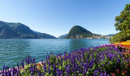 Lugano, Switzerland - Juli 31, 2014: Images of the Gulf of Lugano and Ciani park, botanical park of the city.