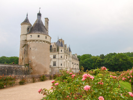 the circumstances: Chambord, France - June 7, 2014:Chateau de Chambord. View of part of the castle and the garden circumstances.