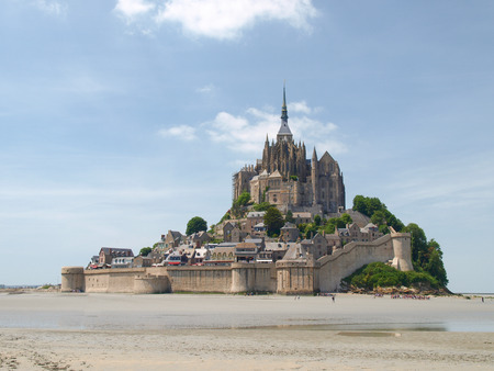 st michel: Mont St. Michel, France June 13, 2014: Abbey of Mont St. Michel. View of the Abbey from the sands at low tide. There are some unknown persons near the Editorial