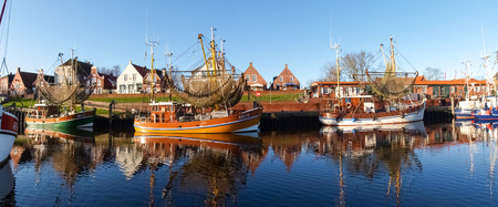 shrimp boat: Greetsiel, Germany - December 6, 2014: Tourist city to the North Sea with a small port. There are several boats moored typical for fishing.