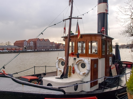 shrimp boat: Leer, Germany - December 8, 2014: Ancient boats moored in the marina. The exposure to the public is free to visiting tourists. Editorial