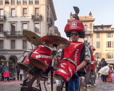 ul: Lugano, Switzerland - february 12, 2015: Carnival Lugano Ul Sbroja, Guggenmusic Fracassband and Spacatimpan sounds in the town hall square and the streets in celebration.