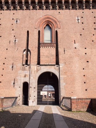 brick facades: Pavia, Italy - March 8, 2015: Visconti Castle. Medieval building with red brick facades and a large garden mainsails. Steps under the arches make it protected from bad weather. The castle garden is used for summer shows. Editorial