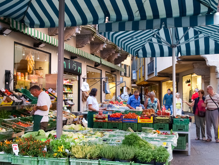 e market: Lugano, Switzerland - september 25, 2014: Lugano, Switzerland. Fruit e vegetable market on the streets of the old town. They meet various commercial activities. Editorial