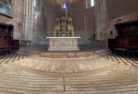 addressed: Pavia, Italy - March 8, 2015: Basilica di San Michele Maggiore. The massive marble altar offers, forehead addressed to us, the figures of St. Michael the Archangel, with the balance of psicostasis, ie weighing of souls Editorial