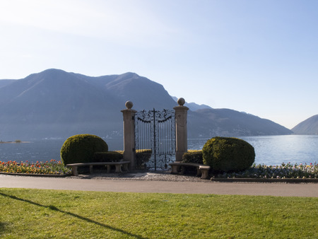 separating: Lugano Switzerland Parco Ciani famous gate to the lake separating the access of old villa and its flower garden