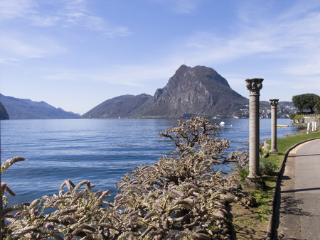 Lugano Castagnola Switzerland April 8 2015: The museum park of cultures with ancient columns and the Gulf of Lugano photo