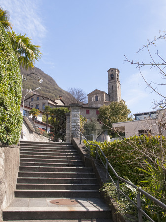 Lugano Castagnola Switzerland April 8 2015: Church of San Giorgio and the staircase That Allows the ascent pedestrian in the old core photo