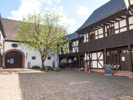 hearse: Kaiserslautern, Germany - April 18, 2015: Theodor-Zink-Museum, Garden inside the museum with old carriage used as a hearse. The house is plastered and painted white very bright