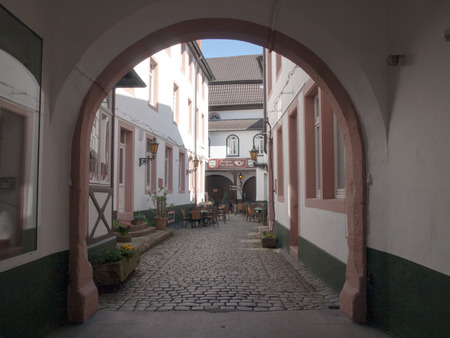 der: Neustadt an der Weinstrasse, Germany - April 19, 2015: Small courtyard in a house in the old town pedestrian.
