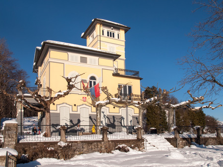br: Monte Br, Switzerland - February 22. 2015: Winter landscape from Monte Bre. View of the facade sunlight restaurants summit with flags exposed to Switzerland, Ticino canton and city of Lugano