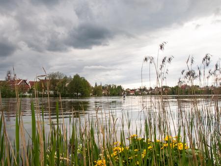 nestled: Bad Waldsee, Germany: City lake nestled in the park