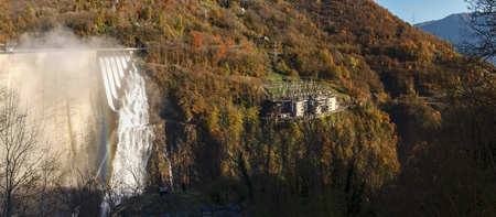 contra: Dam of Contra Verzasca Ticino, Switzerland: spectacular waterfalls from the overflow of the lake over the dam