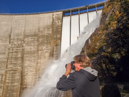 contra: Verzasca Ticino, Switzerland - november 13, 2014: Dam of Contra Verzasca, unknowed fotograph near the spectacular waterfalls during the particulary weather of this season.
