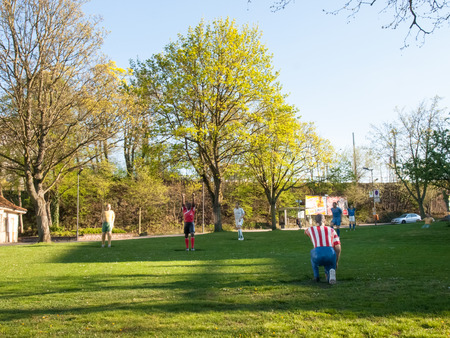 ballsport: Kaiserslautern, Germany - April 18, 2015: Statues of soccer players are positioned on a public garden. Symbolize the passion that lives this city for the sport of football. Stock Photo