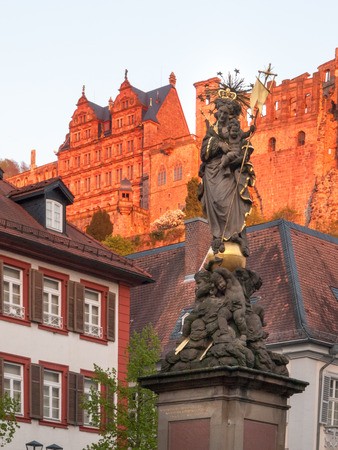 altstadt: Heidelberg, Germany - April 20, 2015: Schloss oberhalb der Altstadt. The view from the old town to the castle in the late evening light almost at sunset
