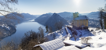 br: Monte Br, Switzerland - February 22. 2015: Winter landscape from Monte Bre. View of the summit restaurant, currently closed for the winter. Many tourists climb to the view of the Gulf of the city
