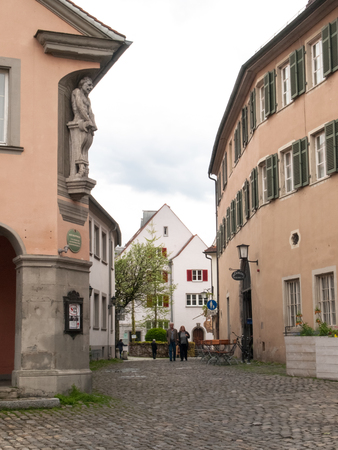 bayern old town: Lindau, Germany - May 2, 2015: Town Lindau- Streets of Old Town with tourists and residents during a weekend day.