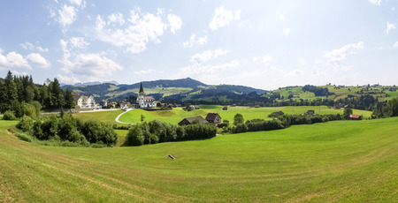 country church: Switzerland: Swiss panorama. country church with Hills in the background Stock Photo