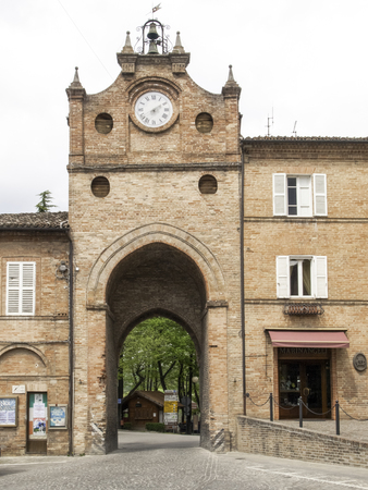 sibillini: Italy, Sarnano - april 24, 2015: Town square with passage under the tower which gives access to the old town. Small medieval village in the second half of the twelve hundred. Editorial