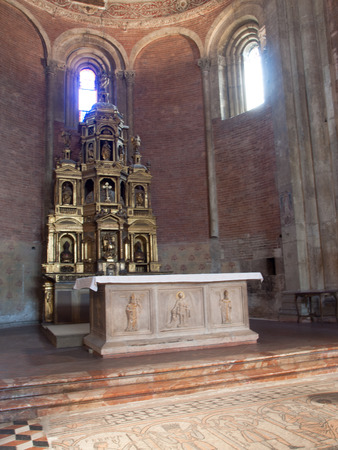 Pavia, Italy - March 8, 2015: Basilica di San Michele Maggiore. The massive marble altar offers, forehead addressed to us, the figures of St. Michael the Archangel, with the balance of psicostasis, ie weighing of souls Editorial