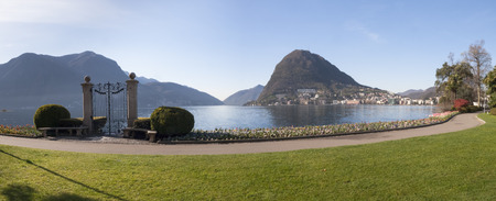 separating: Lugano, Switzerland: Parco Ciani, famous gate to the lake separating the access of old villa and its flower garden