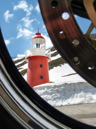 bridging: Oberalppass, Switzerland - June 4, 2015: The lighthouse at Oberalp Pass, a reproduction of Unter feuer of Hoek van Holland, bridging from the source to the mouth of the Rhine.