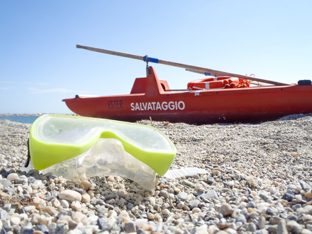 bather: San Bartolomeo, Italy - June 17, 2015: lifeboat bathers resting on the beach