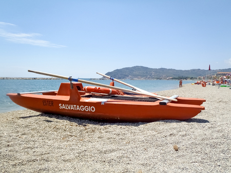San Bartolomeo, Italy - June 17, 2015: lifeboat bathers resting on the beach