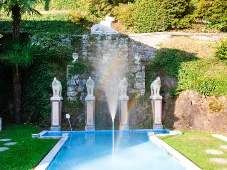 Morcote, Switzerland - Juli 9,2015: Scherrer Park. Called The Garden of Wonders. houses a rich collection of art objects from different countries and different eras, surrounded by lush vegetation and buildings and works of art of various kinds from all