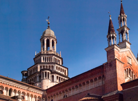 monastic: Certosa di Pavia, Italy - March 8, 2015: Cloister with views of the churchs domes and spiers. Especially the red brick used for construction and the light color marble.