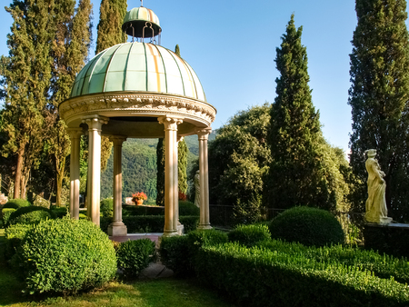 eras: Morcote, Switzerland - Juli 9,2015: Scherrer Park. Called The Garden of Wonders. houses a rich collection of art objects from different countries and different eras, surrounded by lush vegetation and buildings and works of art of various kinds from all