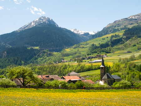 Lukmanierpass Walley, Switzerland: View of the Lukomanierpass Walley. The valley is illuminated by the sun during a beautiful day on the day of the Feast of the Ascension. Stock Photo