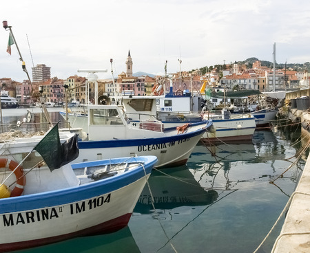 commercial fishing: Oneglia, Italy - June 9, 2015: Marina and fishing. Several fishing boats are moored. In the background the buildings typical of Oneglia.