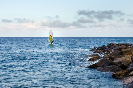 Oneglia, Italy -  Windsurfing in the evening light