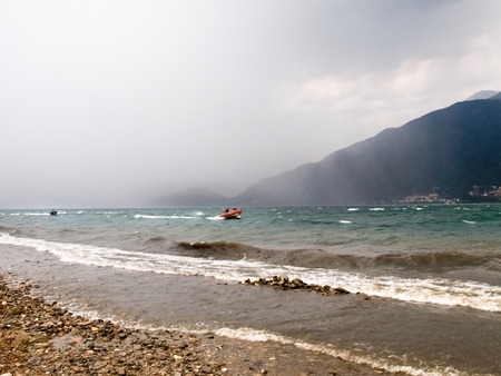 Pianello del Lario, Italy: Storm on the lake, creates a surreal atmosphere with waves and storm on the horizon Stock Photo