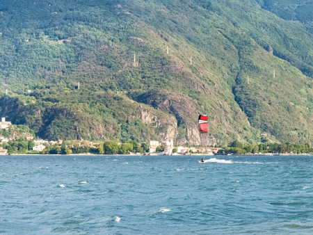 wide  wet: Cremia, Italy: Several windsurfing and kitesurfing with thermal wind from the south on Lake Como. Stock Photo
