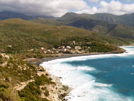 corse: Corsica, France: Coast of Cap Corse and Nonza Beach in rough seas and strong Mistral wind