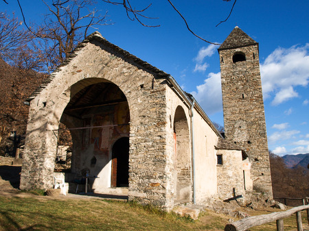 Sementina, Switzerland - december 9, 2016: Church of St. Bernard in the chestnut on Mornera. Ancient Romanesque church, in a tight angle but enriched with frescoes depicting the Madonna del Latte. Editorial