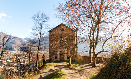 enriched: Sementina, Switzerland - december 9, 2016: Church of St. Bernard in the chestnut on Mornera. Ancient Romanesque church, in a tight angle but enriched with frescoes depicting the Madonna del Latte. Editorial