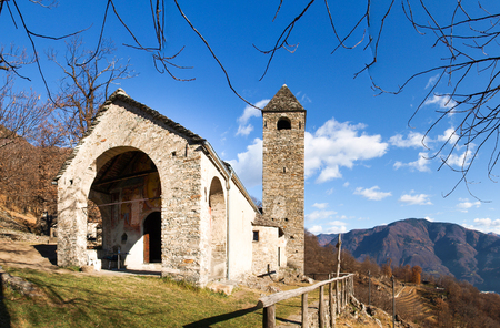 oratoria: Sementina, Switzerland - december 9, 2016: Church of St. Bernard in the chestnut on Mornera. Ancient Romanesque church, in a tight angle but enriched with frescoes depicting the Madonna del Latte. Editorial