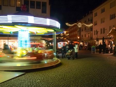 friedrichshafen: Friedrichshafen, Germany - November 28, 2015: funfair and huts for the Christmas market with floodlights