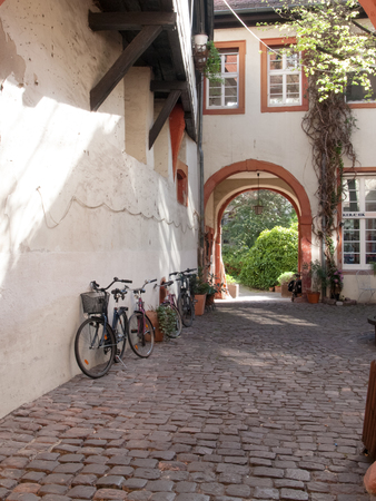 Heidelberg, Germany - April 20, 2015: Small courtyard in a house in the old town pedestrian.