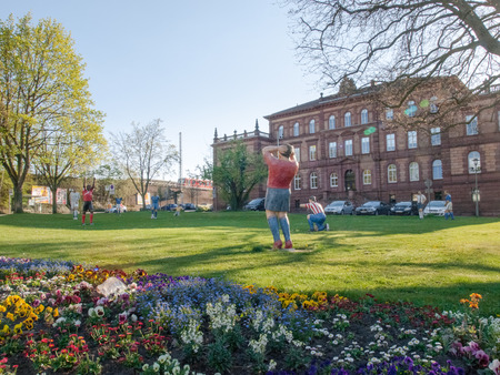 Kaiserslautern, Germany - April 18, 2015: Statues of soccer players are positioned on a public garden. Symbolize the passion that lives this city for the sport of football. Editorial