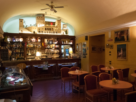 reminiscent: Italy, Gubbio - april 23, 2015: Ancient traditional bar furnished in wood. The soft lighting evening a touch of sweet and peaceful atmosphere reminiscent of ancient times. Editorial