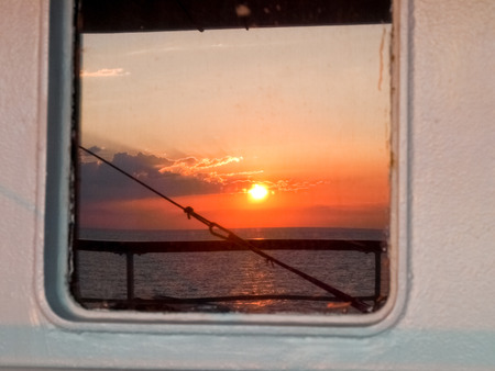 corsica: Corse - Corsica, France: Sunset reflected from the Window on ferry