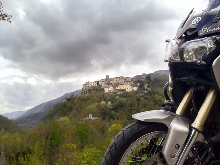Italy, Apennines Umbria, Marche, Abruzzo - april 24, 2015: Panorama of the Apennine hills Umbria-Marche-Abruzzo, with motorbike on the side of image.