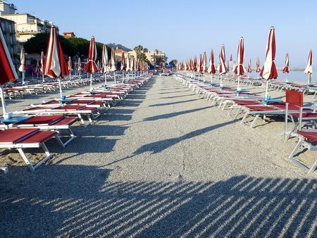 Diano Marina, Italy: Beach umbrellas positioned at regular file Stock Photo